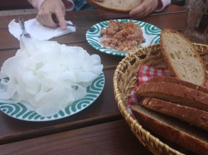 "Lard with pork skins as spread on bread; the white ""fluff"" is salted and cut daikon radish"
