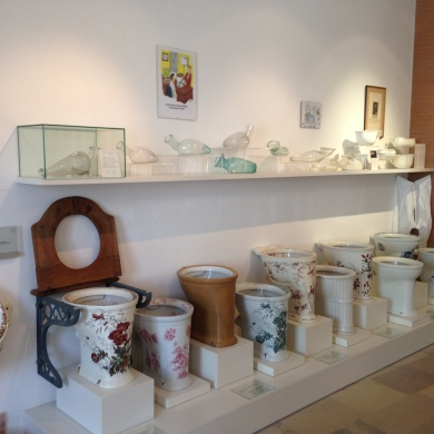 A Row of Toilet Bowls and More on Display at the Museum